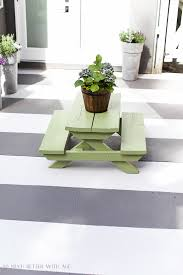 how to paint stripes like an outdoor rug on a concrete slab so much better
