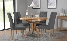 gallery hudson round oak extending dining table with 6 regent slate chairs