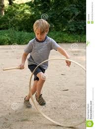 Image result for Australian kids swiveling a wooden hoop