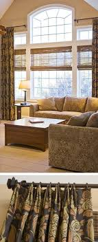 living room window treatments for large windows. the natural woven shade adds another nice texture to this living room. while also letting in some light above it, exposing rest of window. room window treatments for large windows u