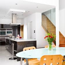 basement kitchen designs. Clean-lined Modern Fitted Kitchen With Table, Chairs And Wooden Stairs. Basement Designs