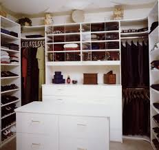 furniture white wooden closet with some racks and white cloth hook connected by white wooden