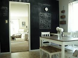 kitchen black chalkboard wall simple white wooden chair table legs with brown tabletop flowers in