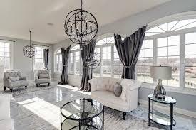 beautiful living room with tile floors dark curtains