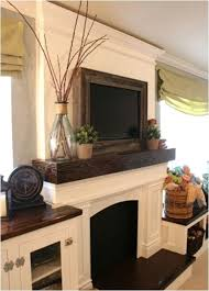 like the chunky dark wood mantle and matching counter top plus 9 different  ways to display your flat screen TV