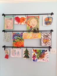children s art displayed with ikea curtain rods