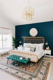 experiment with a bed frame that fits your unique style take inspiration from this room s gorgeous curved rattan frame