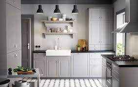 A Country Kitchen With Grey Inset Doors, Black Worktops And Chrome Handles  Knobs. Ikea