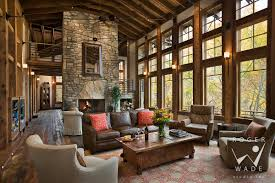 timber frame home interiors. living room toward fireplace and windows looking out to fall color, balsam, nc timber frame home interiors t