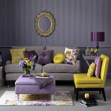 purple living room furniture. Regal Living Room Design With Walls Of Gray And Purple Stripes Highlighting A Brushed Gold Sunburst Mirror. Furniture