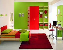 bedroom green wall theme and red wooden wardrobe connected by green striped bedding set on