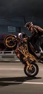 1125x2436 Urban Biker Doing Wheelie ...