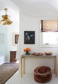 bathroom with brass lotus pendant light