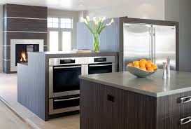 open oven in kitchen. example of a minimalist open concept kitchen design in denver with stainless steel appliances, flat oven