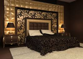 Gold and black theme master bedroom with large area rug.