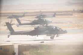 photo essay us army apaches black hawks in rotor u s army ah 64e apache pilots prepare to depart for a mission