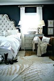 cowhide rug bedroom layered cowhide rug cowhide rug bedroom layering rugs home decor trend cowhide rug