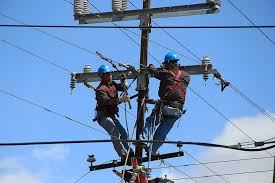 electrical power line installers and repairers wire telephone poles free photo on pixabay