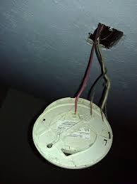 electrical how do i cap the wires in this electric smoke alarm enter image description here electrical smoke detectors