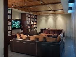 industrial track lighting. Industrial Track Lighting Home Theater With Black Floor Terrazzo. Image By: EANF