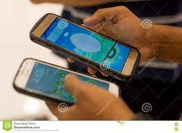 Man Playing Pokemon Go on Multiple Phones Editorial Photo - Image of game,  outsource: 75722161