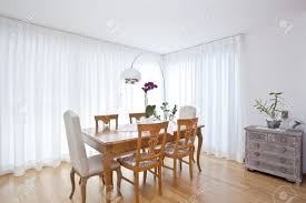 Modern Dining Room With White Curtains Stock Photo Picture And - Modern dining room curtains