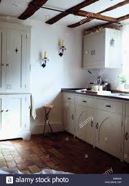 Brick Flooring In Kitchen Old Brick Flooring In White Country Cottage Kitchen Stock Photo