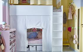 A shared kids' room at night with a loft bed and a bed underneath that