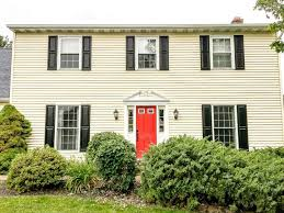 after yellow house with black shutters red door