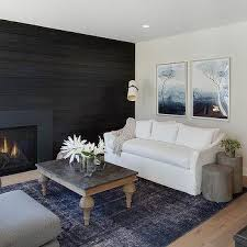 white sofa with blue overdyed rug