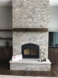 heat glo northstar with silver travertine stacked stone gagnon