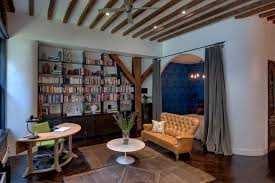 feng shui melrose industrial home office and bedroom blue wallpaper curved desk curved walls eclectic exposed beams feng shui flatweave area rug industrial