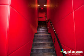 between the black clad doormen wearing earpieces the padded red leather walls and red lacquer counters it s clear from the start that the bryant park