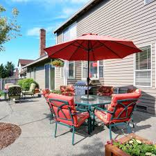 use table umbrellas for roomy level patios