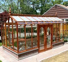 a beautiful nantucket model redwood greenhouse