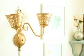 brass wall sconce wired as a plug in