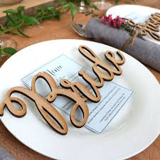 make the bride groom or the brides and grooms standout with these over sized wooden names or signs designed in a beautiful calligraphy font they are