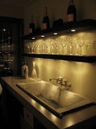 basement bar lighting. under lighting with open shelves for a bar idea plus large sink basement