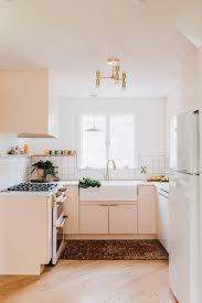 the orange countertops were swapped for custom concrete countertops the cabinets were painted pink ground
