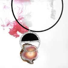black cord necklace with sterling silver circular pendant and iris agate stone