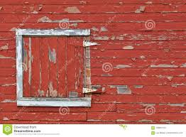 red and white barn doors. A White Framed Barn Door With Peeling Paint Shows On Red Siding. And Doors