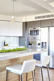 whole kitchen cabinets richmond indiana beautiful minimalist white modern kitchen with a garden strip in the counter