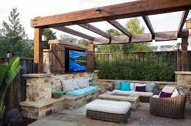 pergola with outdoor tv fireplace and cozy seating design west bay landscape