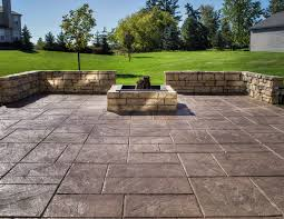 stamped concrete patio enhanced with a fire pit and seat wall