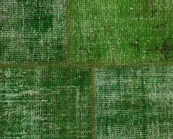 dark green overdyed patchwork carpet
