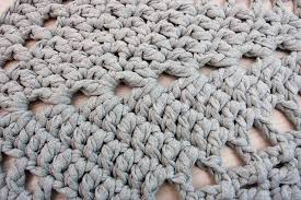 grey star shaped crochet doily rug