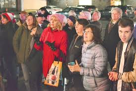 members of the interfaith and jewish munity pare in the first ever menorah lighting ceremony in