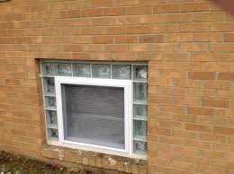 vinyl hopper egress window with glass blocks in an apartment complex