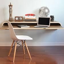 A floating wall desk, designed by Dario Antonioni, has no legs! Measures  15.8