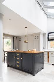 The kitchen island in the Blackheath project has our Westminster smoked oak  worktop which works brilliantly with the painted Longford cabinetry and  brass ...